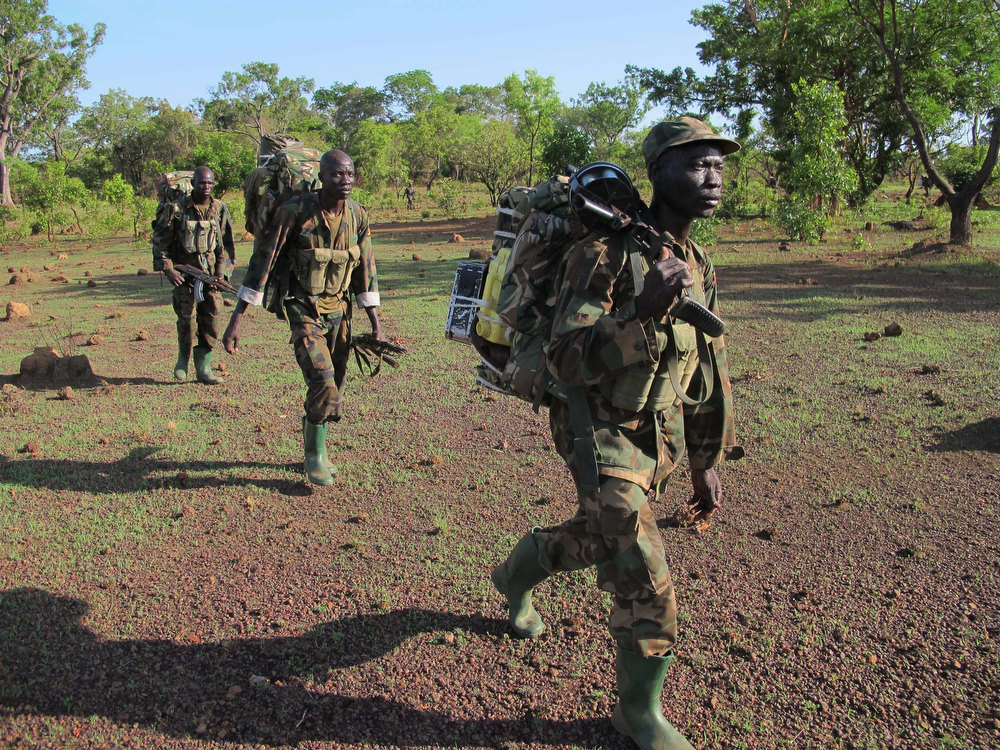 . In this photo of Thursday April 19, 2012 Ugandan soldiers hunting for fugitive warlord Joseph Kony�deep in the Central African Republic jungle patrol the area. For Ugandan soldiers tasked with catching Joseph Kony, the real threat is not the elusive Central Africa warlord and his brutal gang. Encounters between Ugandan troops and Lord\'s Resistance Army rebels are so rare that the Kony hunters worry about other things when they walk the jungle: armed poachers, wild beasts, honey bees, and even a widely-ranging fly that torments their ears during day. Joseph Kony ranked as Google\'s nineth most searched trending person of 2012. (AP Photo/Rodney Muhumuza)
