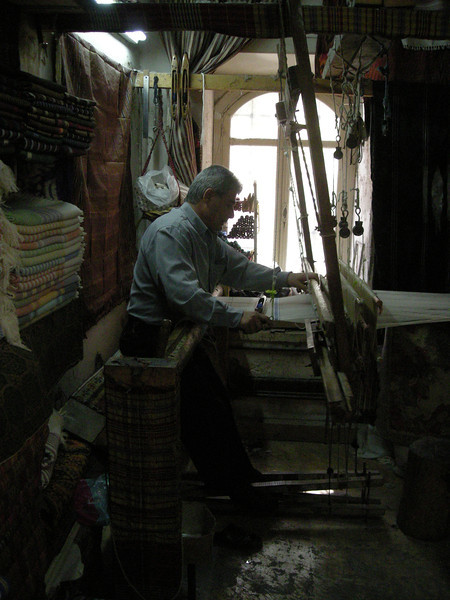 weaving cloth in the Aleppo souq