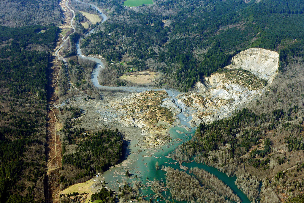 . The massive mudslide that killed at least eight people Saturday and left dozens missing is shown in this aerial photo, Monday, March 24, 2014, near Arlington, Wash. The search for survivors grew Monday, raising fears that the death toll could climb far beyond the eight confirmed fatalities. (AP Photo/Ted S. Warren)