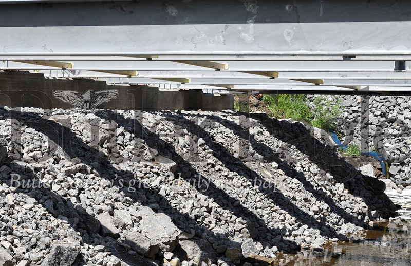 Harold Aughton/Butler Eagle: The shadows under the Chicora bridge will soon disappear as workers from Gregory Construction in Saxonburg were putting the decking on the new bridge, Tuesday, July 28, 2020.