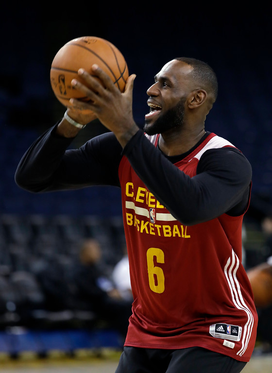 . Cleveland Cavaliers\' LeBron James smiles as he shoots during an NBA basketball practice, Wednesday, May 31, 2017, in Oakland, Calif. The Cavaliers face the Golden State Warriors in Game 1 of the NBA Finals on Thursday in Oakland. (AP Photo/Marcio Jose Sanchez)
