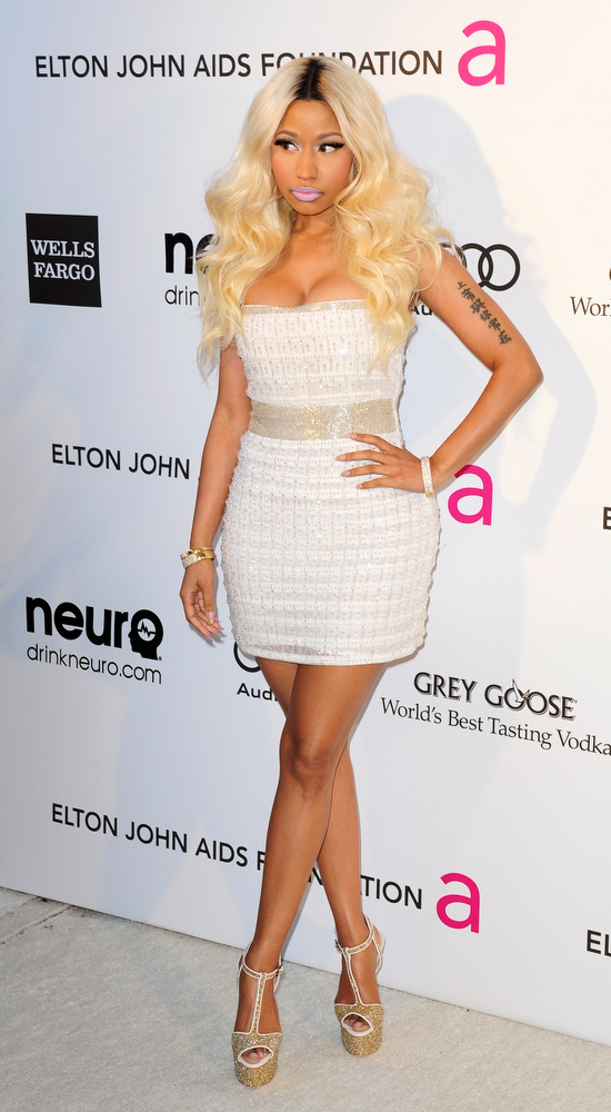 Description of . Singer Nicki Minaj arrives at the 2013 Elton John AIDS Foundation Oscar Party in West Hollywood, California, February 24, 2013.  REUTERS/Gus Ruelas