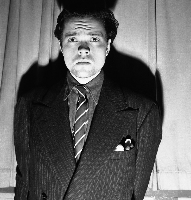 """. Orson Welles, radio and stage actor, whose dramatization, Oct. 30, 1938 of an H. G. Wells novel titled \""""War of the Worlds\"""" which related the \""""invasion\"""" of New Jersey by a horde of men from mars was interpreted by listeners as an actual news broadcast of the events supposed to presume the end of the world. Panicked listeners fled into streets to get away from the invaders: radio and police stations were swamped with calls all over the country - the broadcast was nationwide (CBS) - and in Newark 15 persons were treated for shock after they rushed out of their homes to escape what appeared to be certain doom. Welles, after the broadcast. (AP Photo)"""