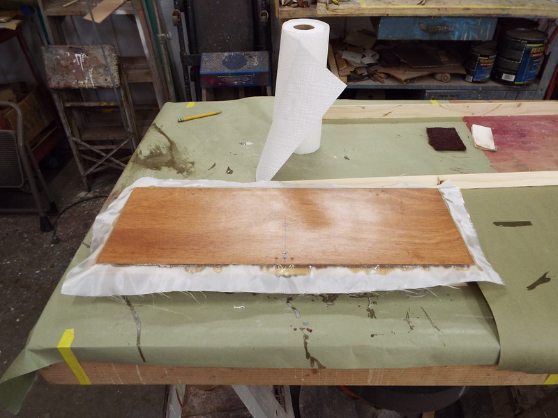 Back side of the storage locker door with a layer of glass added with epoxy resin.