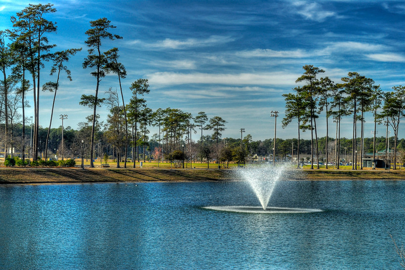 A view of Grand Park across the lake at The Market Common, a popular shopping, residential, and entertainment complex, in Myrtle Beach, SC on Wednesday, February 15, 2012. Copyright 2012 Jason Barnette