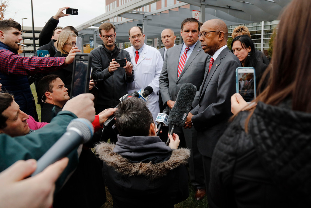 . Ohio State University president Michael Drake, third from right, speaks to journalists following an attack on campus on Monday, Nov. 28, 2016 outside the Ohio State University Wexner Medical Center in Columbus, Ohio. Also pictured are Columbus Mayor Andrew Ginther, fourth from right, and Dr. Andrew Thomas, chief medical officer at The Wexner Medical Center, center. (Joshua A. Bickel/The Columbus Dispatch via AP)