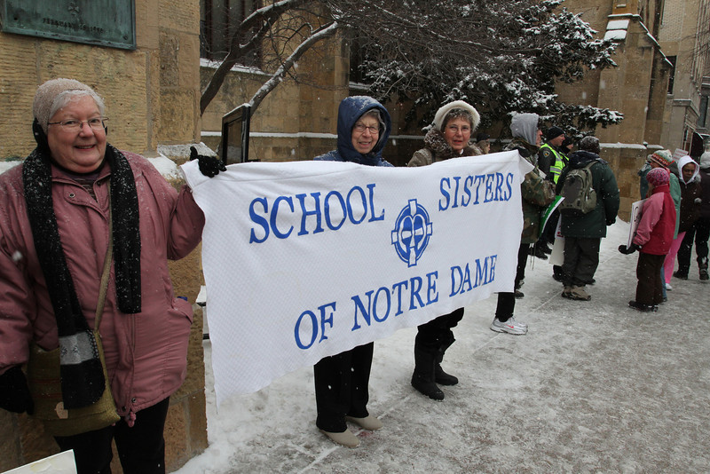 School Sisters of Notre Dame stand in unison outside of Grace Church.