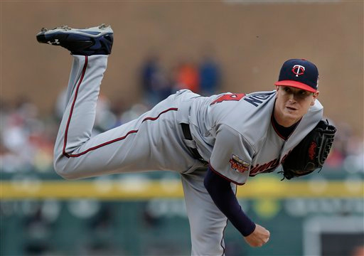 . Minnesota Twins pitcher Kyle Gibson throws against the Detroit Tigers in the second inning of a baseball game in Detroit, Friday, June 13, 2014.  (AP Photo/Paul Sancya)