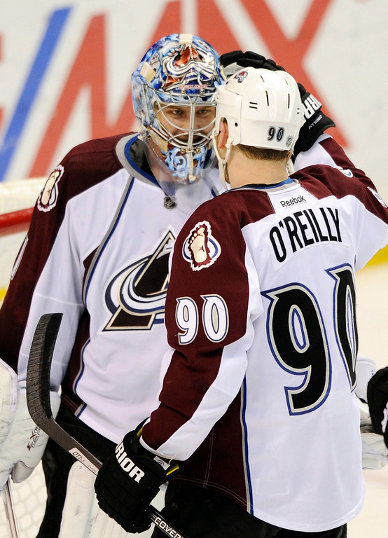 . Colorado Avalanche\'s goalie Semyon Varlamov, of Russia, is congratulated by teammate Ryan O\'Reilly (90) after their victory over the St. Louis Blues in an NHL hockey game, Saturday, April 5, 2014, in St. Louis. The Avalanche won 4-0. (AP Photo/Bill Boyce)