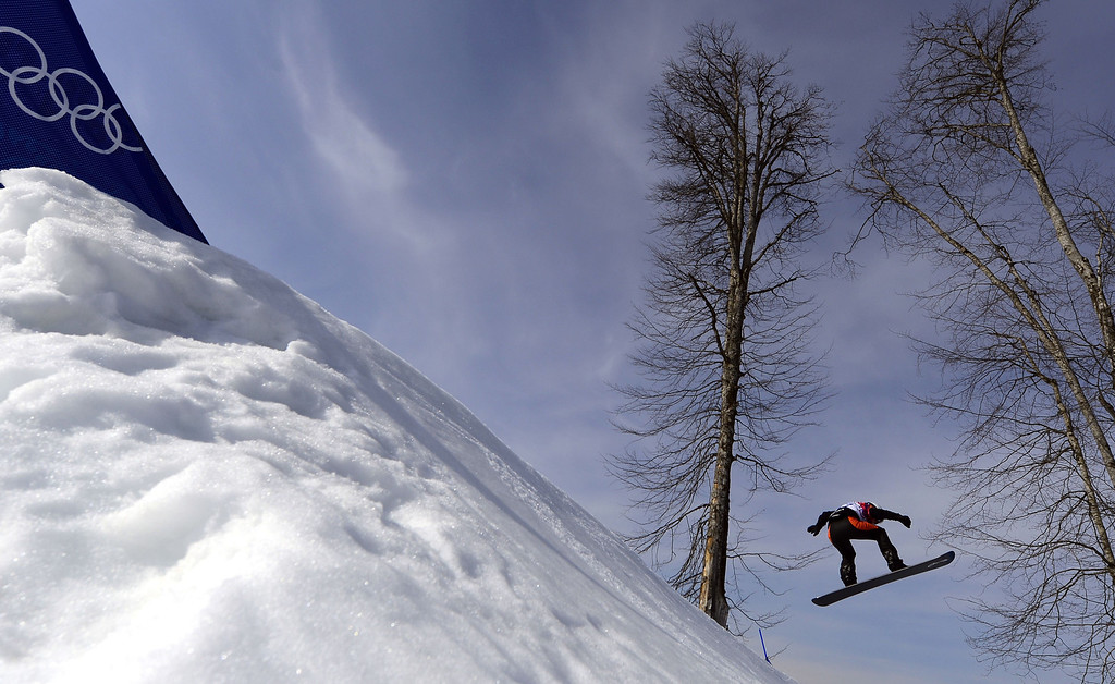 . Netherlands\' Bell Berghuis competes in the Women\'s Snowboard Cross seeding runs at the Rosa Khutor Extreme Park during the Sochi Winter Olympics on February 16, 2014.   JAVIER SORIANO/AFP/Getty Images