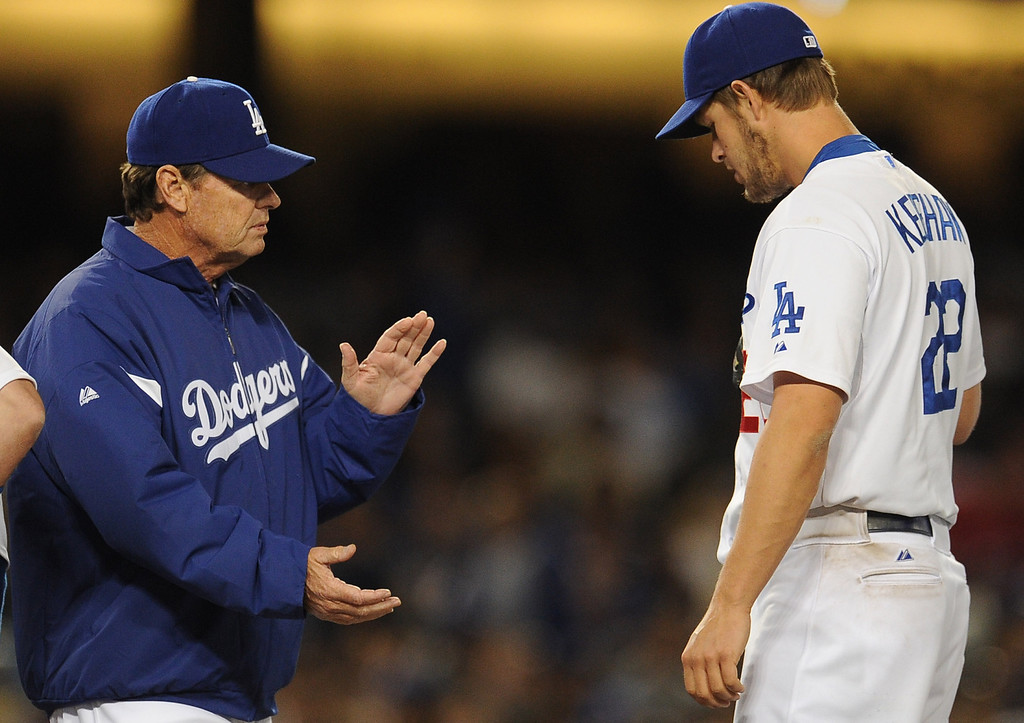 . Los Angeles Dodgers pitching coach Rick Honeycutt talks with starting pitcher Clayton Kershaw after he gave up two runs in the fourth inning of their baseball game against the San Diego Padres on Wednesday, April 17, 2013 in Los Angeles. Kershaw would give-up three runs total in the third innng.   (Keith Birmingham/Pasadena Star-News)