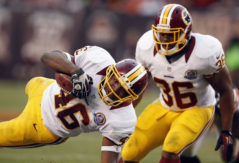 . Running back Alfred Morris #46 of the Washington Redskins dives for extra yardage as fullback Darrel Young #36 looks on against the Cleveland Browns at Cleveland Browns Stadium on December 16, 2012 in Cleveland, Ohio.  (Photo by Matt Sullivan/Getty Images)