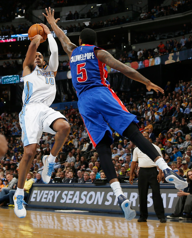 . Denver Nuggets guard Arron Afflalo, left, goes up for shot as Detroit Pistons guard Kentavious Caldwell-Pope covers in the fourth quarter of the Nuggets\' 89-79 victory in an NBA basketball game in Denver on Wednesday, Oct. 29, 2014. (AP Photo/David Zalubowski)