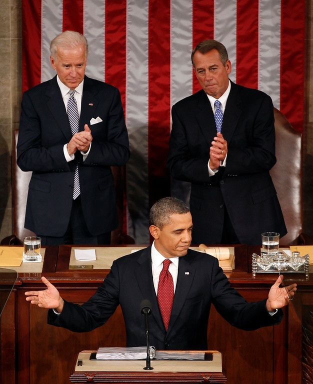 . Vice President Joe Biden and House Speaker John Boehner of Ohio applaud President Barack Obama on Capitol Hill in Washington, Tuesday, Jan. 24, 2012, as the president gives his State of the Union address. (AP Photo/J. Scott Applewhite)