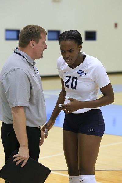 Coach Taylor converses with Geradar Victor