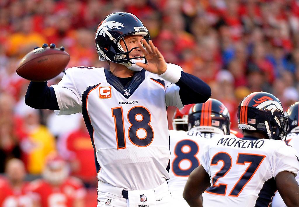 . Denver Broncos quarterback Peyton Manning (18) drops back to pass against the Kansas City Chiefs on Dec. 1, 2013 at Arrowhead Stadium.  (Photo by John Leyba/The Denver Post)