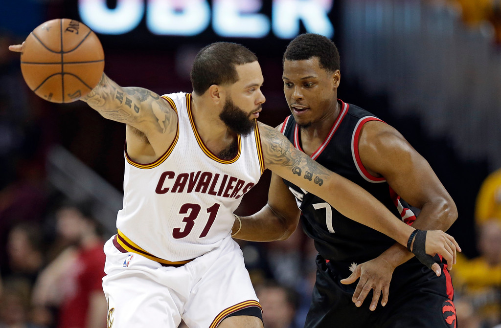 . Cleveland Cavaliers\' Deron Williams (31) drives past Toronto Raptors\' Kyle Lowry (7) in the first half in Game 1 of a second-round NBA basketball playoff series, Monday, May 1, 2017, in Cleveland. The Cavaliers won 116-105. (AP Photo/Tony Dejak)