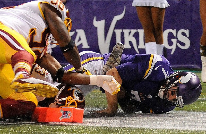 . Minnesota Vikings quarterback Christian Ponder tries to dive into the end zone and is injured during the third quarter. (Pioneer Press: Sherri LaRose-Chiglo)