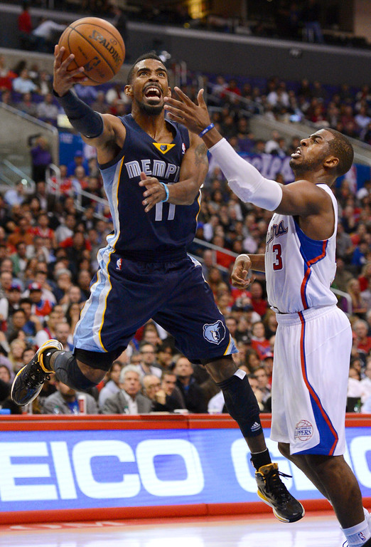 . Los Angeles Clippers\' Chris Paul tries to defend Mike Conley of the Memphis Grizzlies during the second half Monday, Nov. 18, 2013, in Los Angeles.  The Clippers lost the game 106-102.(Andy Holzman/Los Angeles Daily News)
