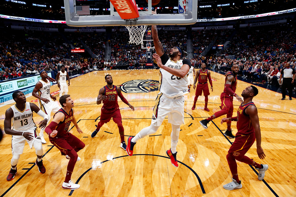 . New Orleans Pelicans forward Anthony Davis (23) goes to the basket in the first half of an NBA basketball game against the Cleveland Cavaliers in New Orleans, Saturday, Oct. 28, 2017. (AP Photo/Gerald Herbert)