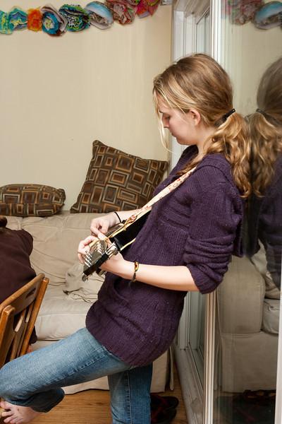 Claudia playing the mandolin.