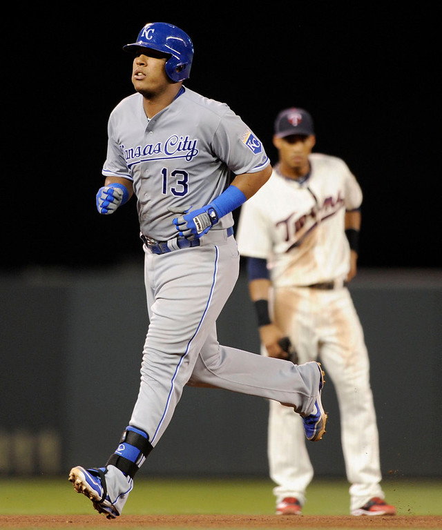 . Pedro Florimon #25 of the Minnesota Twins looks on as Salvador Perez #13 of the Kansas City Royals rounds the bases after Perez hit a two run home run during the fourth inning. (Photo by Hannah Foslien/Getty Images)