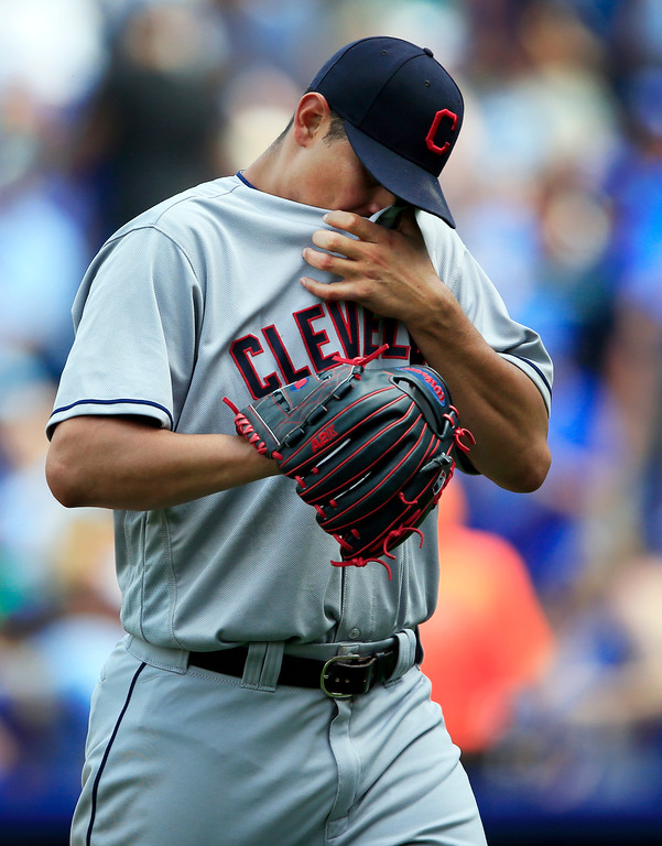 . Cleveland Indians starting pitcher Carlos Carrasco wipes his face as he leaves during the fifth inning of a baseball game against the Kansas City Royals at Kauffman Stadium in Kansas City, Mo., Saturday, June 3, 2017. Carrasco gave up six runs in the inning. (AP Photo/Orlin Wagner)