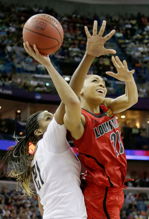 . Louisville guard Bria Smith (21) goes up for a shot against California forward Reshanda Gray (21) in the first half of a national semifinal at the Women\'s Final Four of the NCAA college basketball tournament, Sunday, April 7, 2013, in New Orleans. (AP Photo/Gerald Herbert)