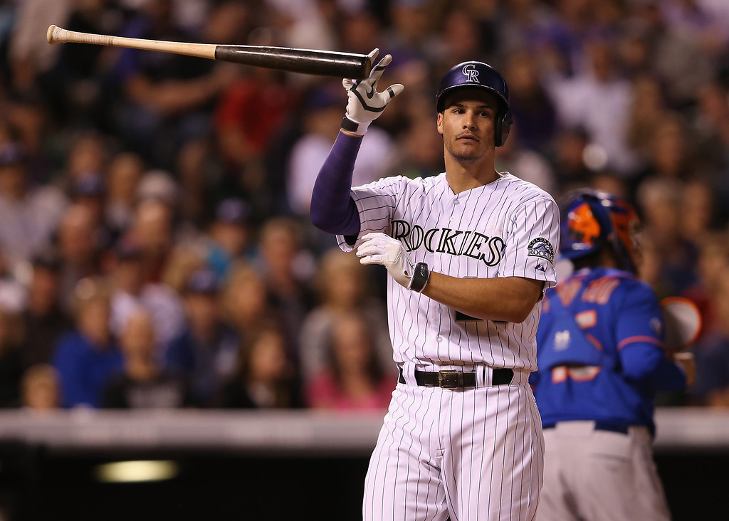 . DENVER, CO - MAY 02:  Nolan Arenado #28 of the Colorado Rockies reacts and tosses his bat after striking out to end the fourth inning against the New York Mets at Coors Field on May 2, 2014 in Denver, Colorado.  (Photo by Doug Pensinger/Getty Images)