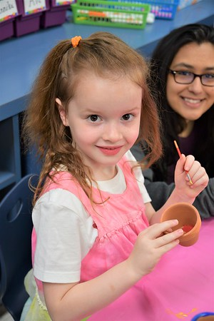 Kindergarten and Eighth Grade Buddies Paint Flower Pots for The Children's Inn