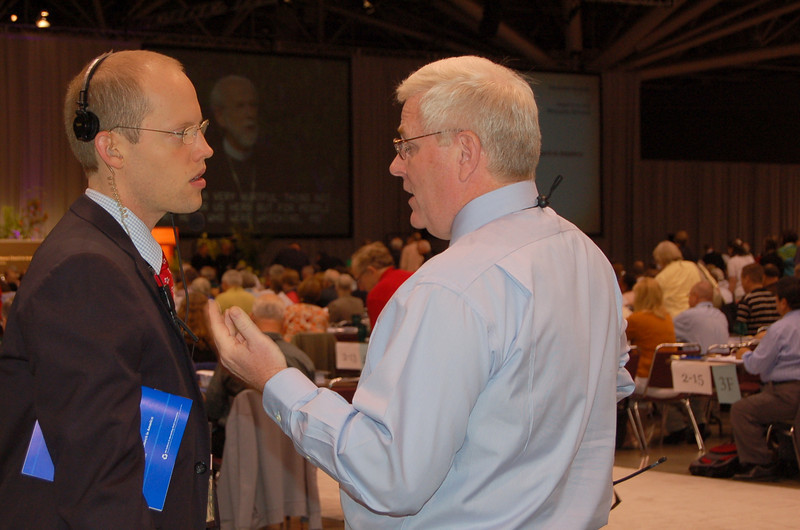 Scott Hendrickson, director for marketing, public relations and creative services confers with John Brooks, associate executive director and director for ELCA News Services.