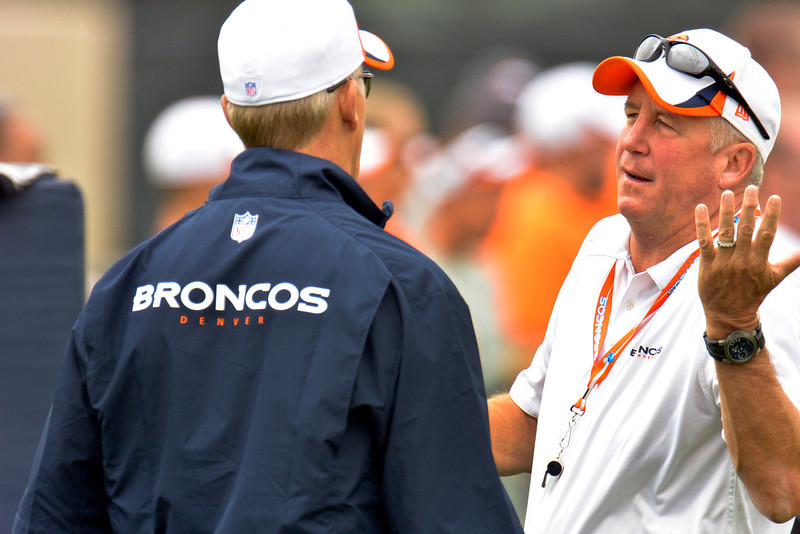 . Denver Broncos head coach john Fox talks with Executive V.P. of Operations John Elway during training camp July 29, 2013 at Dove Valley. (Photo By John Leyba/The Denver Post)