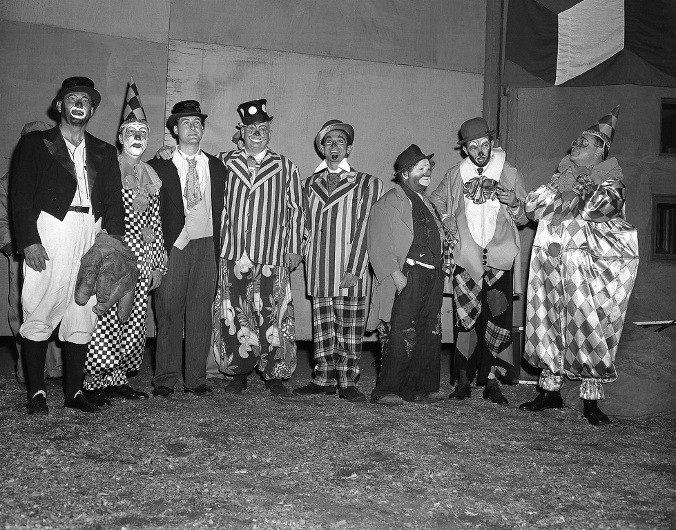 ". Seven of these eight costumed clowns are radio and television personalities, while the eighth (third from right) is Otto Griebling, who earns his livelihood as a clown with Ringling Brothers and Barnum and Bailey Circus. Group gathered at New York\'s Madison Square Garden, April 1, 1953 for opening performance of ""The Greatest Show On Earth.\"" From left are: Al Schacht, perennial baseball clown; Garry Moore, Sid Caesar, Lauritz Melchior, Jack Carter, Otto Griebling, Herb Shriner and Sam Levenson.  The radio and TV personalities participated in the opening night performance with proceeds going to United Cerebral Palsy of New York. (AP Photo/Matty Zimmerman)"