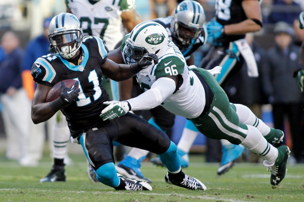 . Carolina Panthers\' Brandon LaFell (11) is tackled by New York Jets\' Muhammad Wilkerson (96) during the first half of an NFL football game in Charlotte, N.C., Sunday, Dec. 15, 2013. (AP Photo/Bob Leverone)