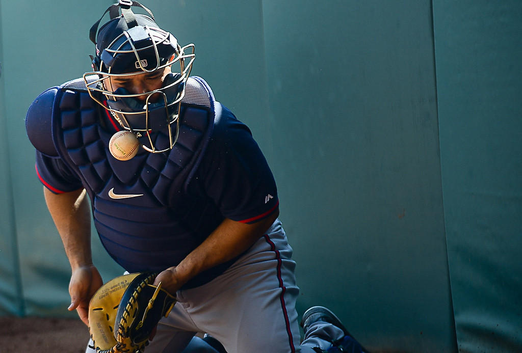 . Twins catcher Josmil Pinto takes a ball off his mask during a bullpen session. (Pioneer Press: Ben Garvin)