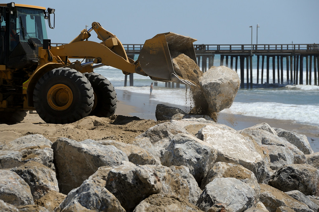 . Public Works crew drops boulders to protect the beach from the big surf at Port Hueneme Beach, Tuesday, August 26, 2014. (Photo by Michael Owen Baker/Los Angeles Daily News)