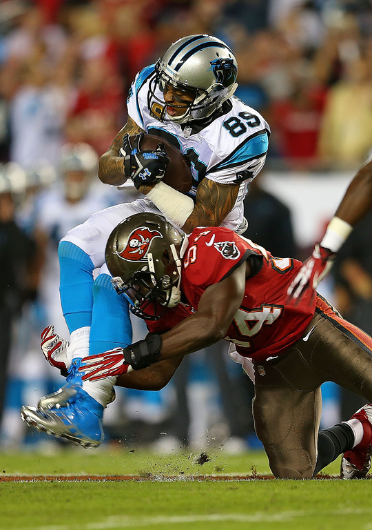 . Steve Smith #89 of the Carolina Panthers is tackled by Lavonte David #54 of the Tampa Bay Buccaneers during a game  at Raymond James Stadium on October 24, 2013 in Tampa, Florida.  (Photo by Mike Ehrmann/Getty Images)