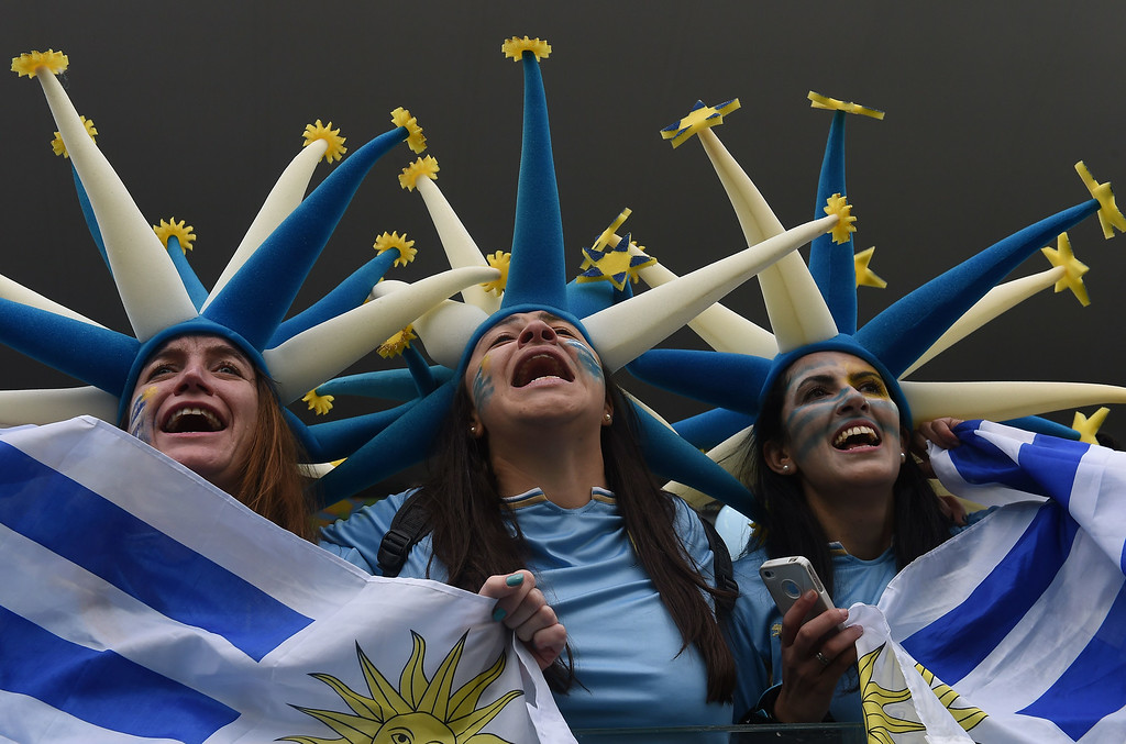. Uruguayan fans cheer before the start of a Group D football match between Uruguay and England at the Corinthians Arena in Sao Paulo during the 2014 FIFA World Cup on June 19, 2014. LUIS ACOSTA/AFP/Getty Images