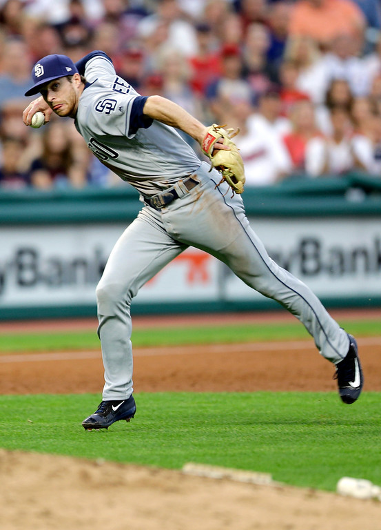 . San Diego Padres\' Cory Spangenberg throws to first base but not in time to get Cleveland Indians\' Michael Brantley in the fifth inning of a baseball game, Wednesday, July 5, 2017, in Cleveland. (AP Photo/Tony Dejak)