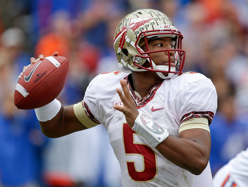 . Florida State quarterback Jameis Winston looks for a receiver during the first half of an NCAA college football game against Florida in Gainesville, Fla., Saturday, Nov. 30, 2013.(AP Photo/John Raoux)