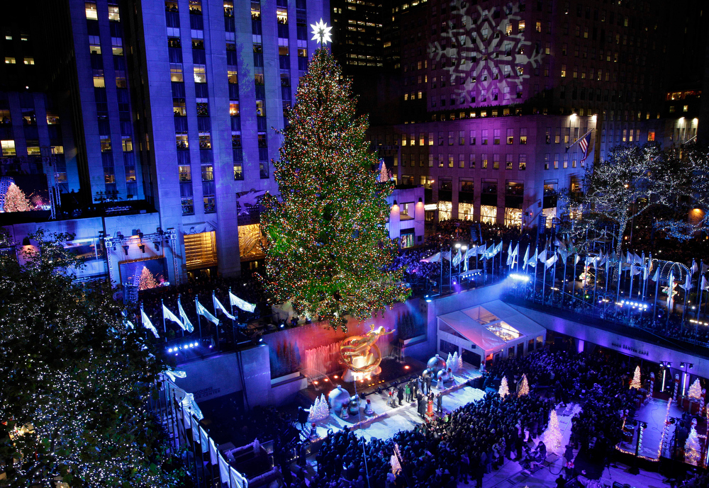 Description of . The Rockefeller Center Christmas Tree is lit during the 80th annual tree lighting ceremony at Rockefeller Center in New York, Wednesday, Nov. 28, 2012.  (AP Photo/Kathy Willens)