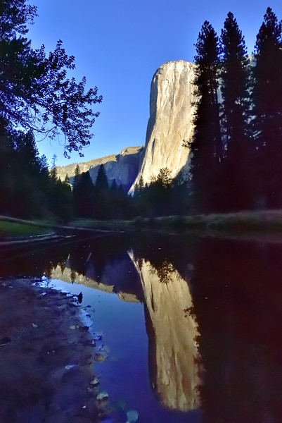 El Capitan reflected in the low, calm water of the Merced River