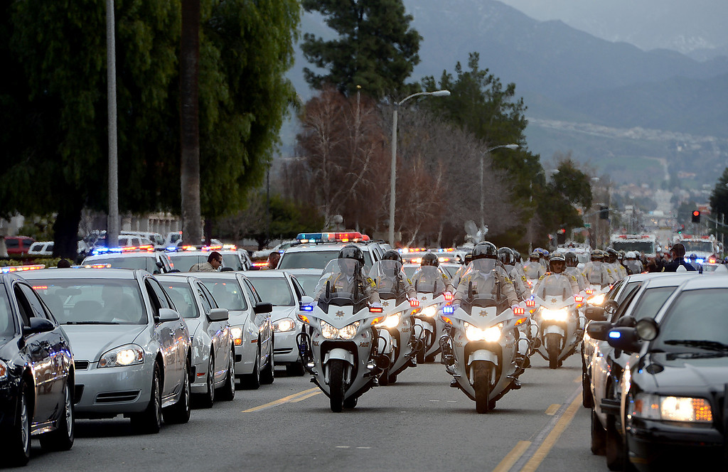 . Law enforcement and fire agency officials from around California and at least three other states get ready to form the funeral procession for San Bernardino Sheriff\'s Detective Jeremiah MacKay Thursday February 21, 2013 at Mt View Cemetery in San Bernardino.