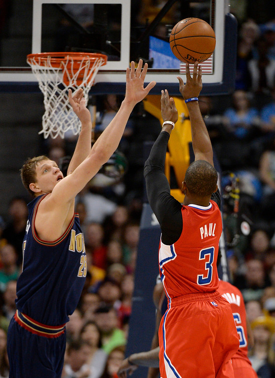 . Los Angeles Clippers guard Chris Paul (3) takes a shot over Denver Nuggets center Timofey Mozgov (25) during the first quarter. (Photo by John Leyba/The Denver Post)