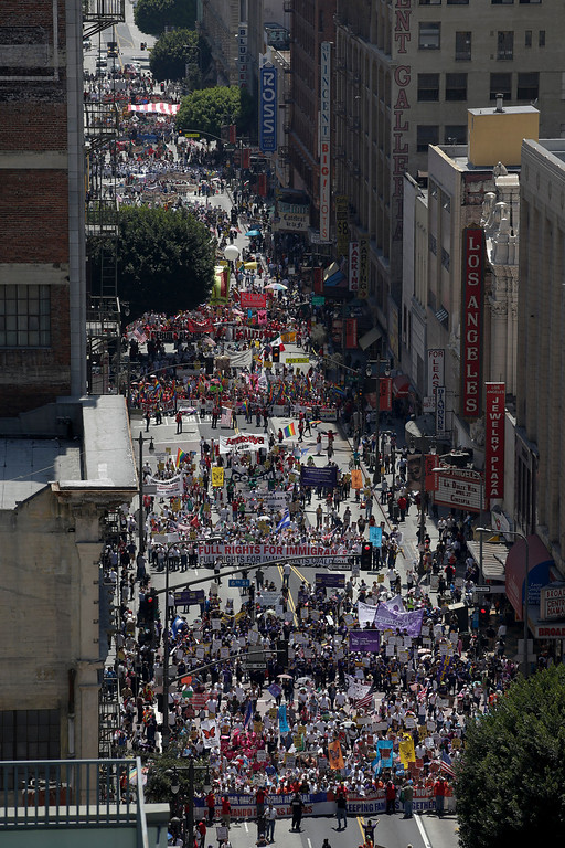 . Marchers walk along during a rally in downtown Los Angeles, Wednesday, May 1, 2013. In celebration of May Day thousands have gathered for an immigration reform rally in downtown. (AP Photo/Jae C. Hong)