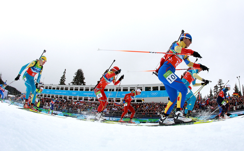 . Competitors flood across the start line during the women\'s biathlon 4 x 6km relay on day 12 of the 2010 Vancouver Winter Olympics at Whistler Olympic Park Cross-Country Stadium on February 23, 2010 in Whistler, Canada.  (Photo by Alexander Hassenstein/Bongarts/Getty Images)