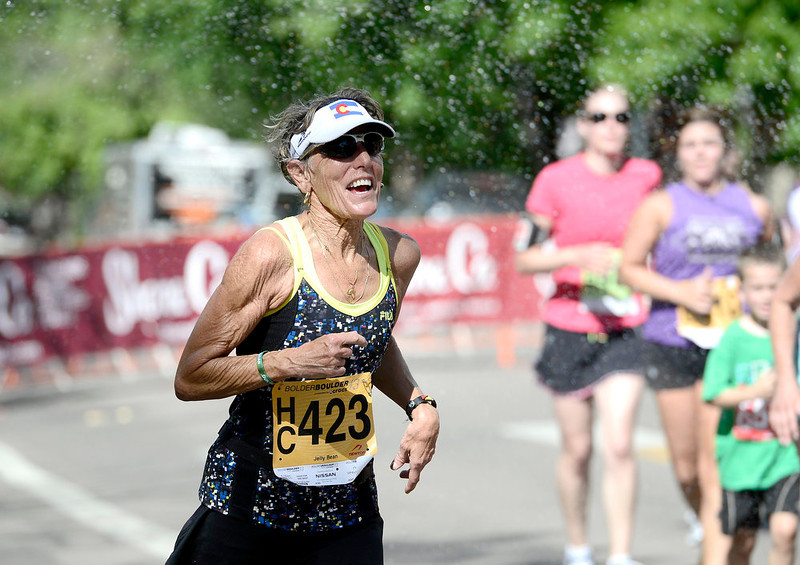 . Jean Wood laughs as water is sprayed on her during the Bolder Boulder in Boulder, Colorado May 27, 2014.  DAILY CAMERA/ Mark Leffingwell