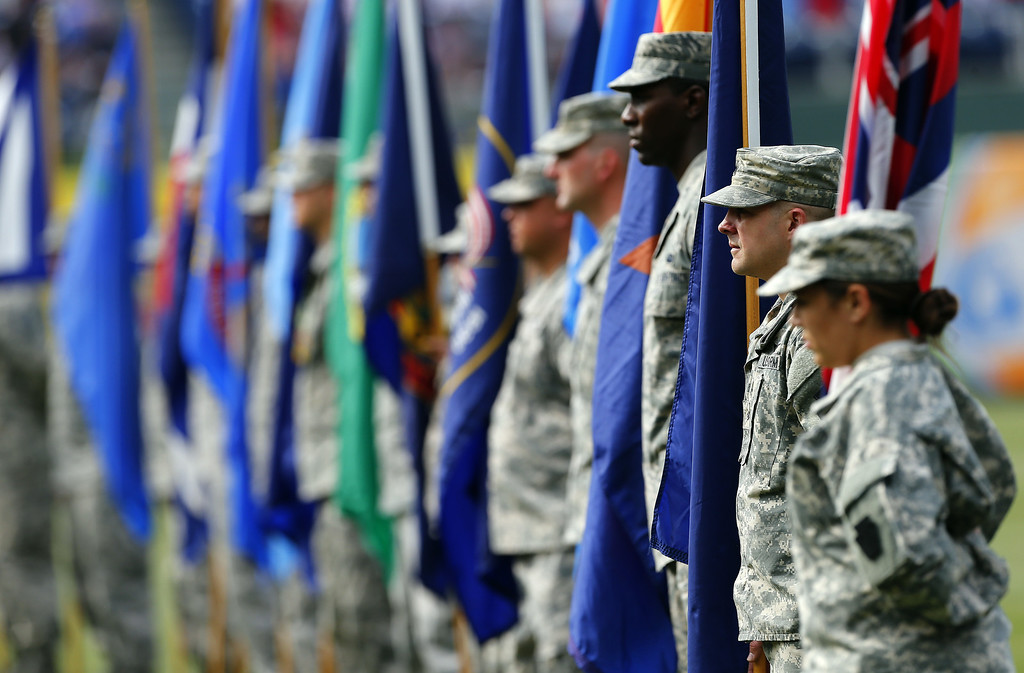. Military personnel hold flags from all 50 states during a Memorial Day ceremony before the start of a game between the Colorado Rockies and the Philadelphia Phillies at Citizens Bank Park on May 26, 2014 in Philadelphia, Pennsylvania. (Photo by Rich Schultz/Getty Images)