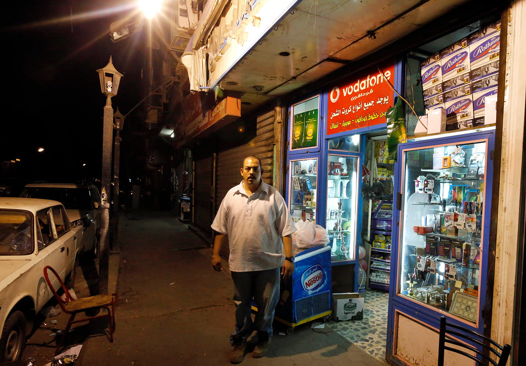 . In this Sunday, Aug. 25, 2013 photo, a man stands outside a shop in Cairo, Egypt, during curfew. The curfew has been a shock to Cairo, a city where cafes stay packed into the night and parents routinely take their children out for dinners nearing midnight. The military-backed government\'s curfew, after violent unrest following the July 3 coup that ousted President Mohammed Morsi, slashed the typical Cairo 24-hour life to just 11 hours.(AP Photo/Lefteris Pitarakis)
