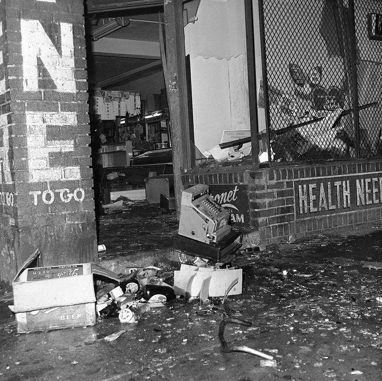. A cash register sits atop debris at a Cleveland drug store looted during rioting in the city�s Hough section, July 19, 1966. Roving gangs of teenagers were responsible for most of the looting and burning of businesses in the predominantly black section. Businesses operated by white merchants were the target in previous rioting the area the last week in June. (AP Photo/Julian C. Wilson)